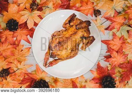 Roast Chicken With Autumn And Fall Season Background. Fake Maple Leaf On Wood Table. Harvest Cornuco