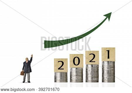 Business Investment And Growth Year 2021 For Advertising Concept. Stacking Coin Growing With Busines