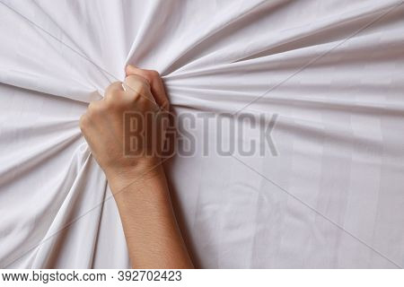 Close Up Young Sexy Woman Hands Pulling White Sheets In Ecstasy In Hotel. Cute Girl Doing Sign Orgas