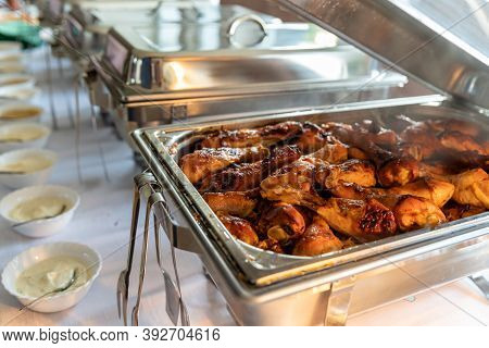 Roast Chicken Thighs In A Warming Pot On A Catering Table