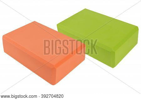Two Colored Yoga Blocks, Green And Orange, On A White Background