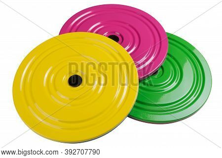 Three Colored Fitness Disc For The Press Lie On Top Of Each Other, On A White Background