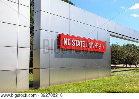 RALEIGH, NC, USA - SEPTEMBER 04, 2020 : Main Entrance Sign on shiny wall at North Carolina State University in Raleigh, North Carolina. It is largest university in both North and South Carolina.