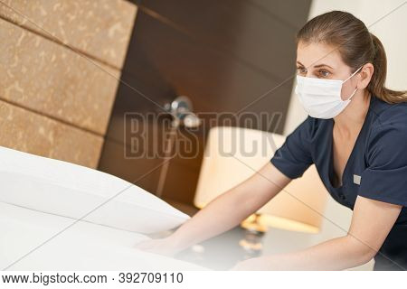 Experienced Chambermaid In Uniform Doing Room Service In Hotel