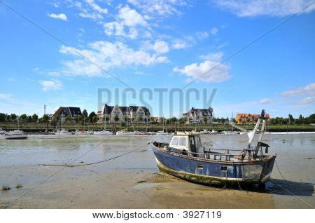 Ebb tide in the little harbor in Normandy poster