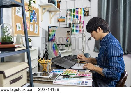 Asian Men Architect Or Graphic Designer Designing A Layout Selection Swatch Samples For Coloring Scr
