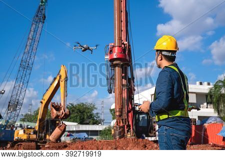 Drone Inspection New Construction Site. Operator Inspecting New Construction Site Control By Civil E