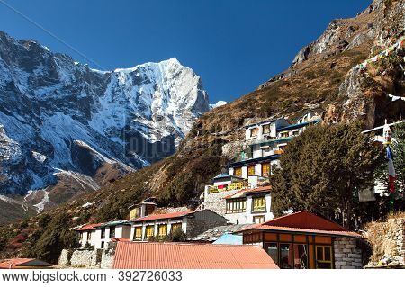 Thame Gompa With Prayer Flags And Buddhist Symbols - Monastery In Khumbu Valley On Three Passes Trek