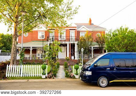 Minibus Taxi Van Parked Outside A House In A Wealthy Neighborhood