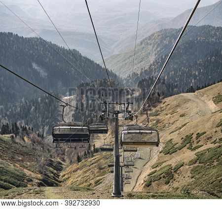 Chairlifts At Autumn Mountains Background In Rosa Khutor Ski Resort