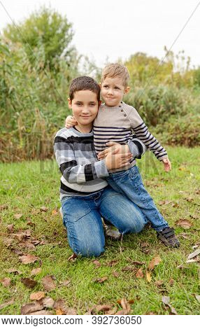 Two Boys Having Fun Together Outdoors. Happy Family. Little Brothers Embracing And Laughing. Love, T