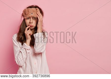 Upset Dejected Woman Purses Lower Lip, Wears Sleepmask, Dressed In Comfortable Pyjamas, Sad Being Wo