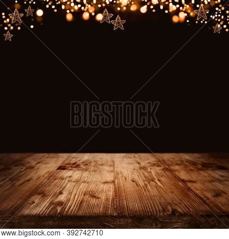 Golden Christmas Stars And Festive Bokeh Lights In Front Of Illuminated Rustic Wooden Square Backgro