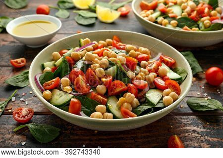Chickpeas Salad With Tomato, Cucumbers, Red Onion And Greens. Dietary Food. Vegan Salad.