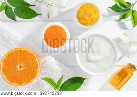 Natural Beauty Products With Orange Fruit On White Wooden Background. Organic Beauty Or Spa Concept.