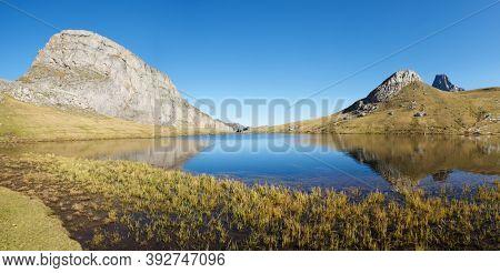 Casterau Peak and Paradis lake. Ayous Lakes in Ossau Valley, Pyrenees National Park, Pyrenees in France.