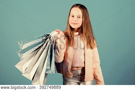Fashion Boutique. Birthday Girl Shopping. Fashion Trend. Fashion Shop. Little Girl With Bunch Packag