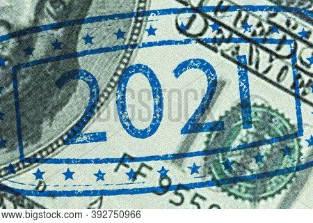 Detail Of Ink Stamping Hundred Dollar Bill; Close Up Of Ink Stamp With Numbers 2021 Representing The