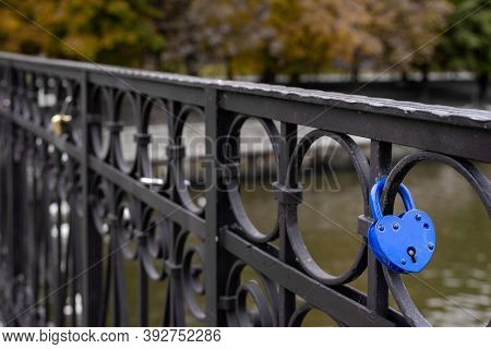 Blue Padlock In The Shape Of Heart Closed By Newlyweds On Their Wedding Day. Symbol Of Eternal Love