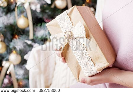 Сhild's  Hands Holding Gift Box. Christmas, Hew Year, Birthday Concept. Festive Background With Boke