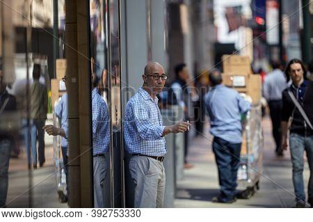 New York Ny 22 April 2015 A Man Walking In Midtown Manhattan.