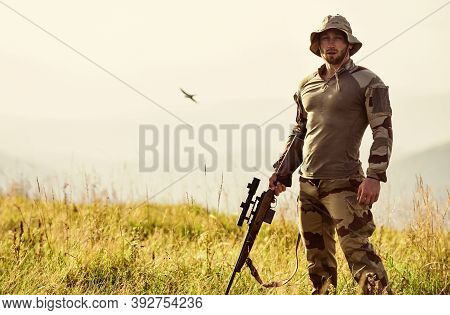 Rifle For Hunting. Hunter Hold Rifle. Hunter Mountains Landscape Background. Ready To Shoot. Army Fo
