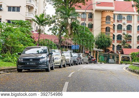 Cars Parked On The Sidelines In A Row. Street In Malaysia. Kuala Lumpur , Malaysia - 05.27.2020.