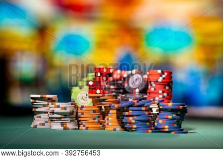 Casino Craps dice and gambling chips close up - Shallow depth of field