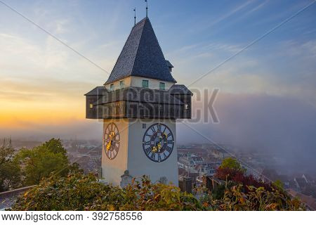 The Famous Clock Tower On Schlossberg Hill, In Graz, Styria Region, Austria, At Sunrise. Beautiful F