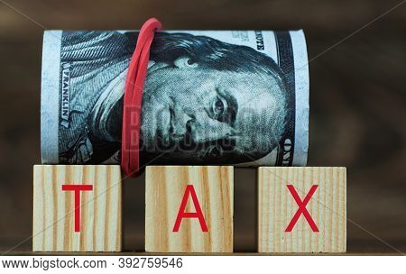 Dollars Marked Gna Tax In Wooden Cubes
