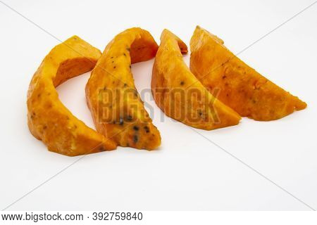 A Rotten Pieces Of Pumpkin. Rotten Vegetable And Spoiled Food. A Product That Has Been Affected By M