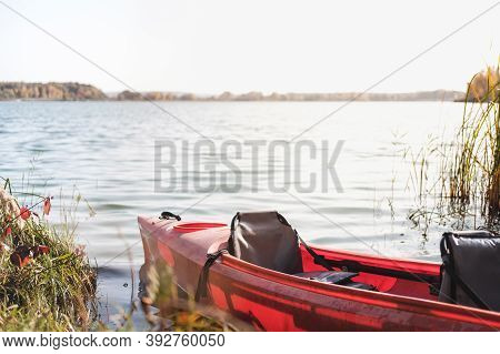 Canoe Boat On The Water, Big Lake. Red Plastic Boat On Water, Active Rest, Boating Vacation