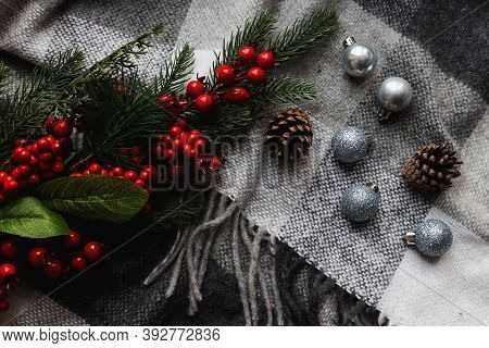Festive Christmas Background With Selective Focus. Christmas Balls Of Silver Color On A Cozy Gray Bl