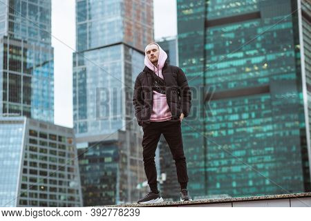 Handsome Casual Man In Black Jacket And Pink Hoody Standing On A Skyscraper View