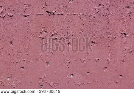 Close Up Texture Of Pink Rough Concrete Wall Or Plaster.
