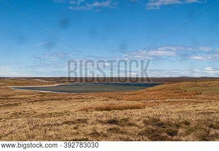 Falkland Islands, Uk - December 15, 2008: Wide Windswept Bare Landscape Of Dry Land Around Bay Under