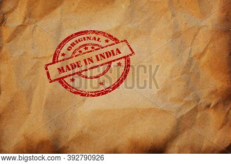 Made In India Stamp Printed On Crumpled Sheet Of Burnt Paper. Indian Product, Parcel, Package, Produ