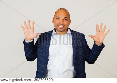 Portrait Of Successful Young African American Businessman Guy, Showing With Fingers To Number Ten, S