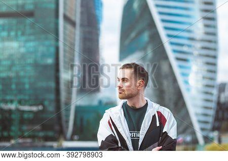 Handsome Casual Man In Windbreaker Standing On A Skyscraper View