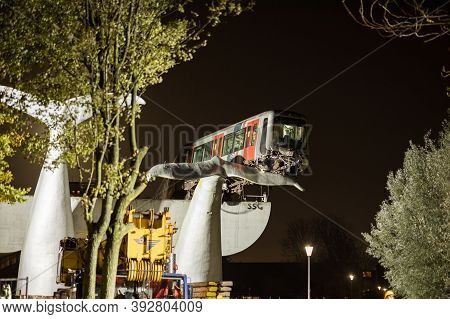 Spijkenisse, The Netherlands - November 2, 2020: Whale Tail Sculpture Stops Rotterdam Metro Train Fr