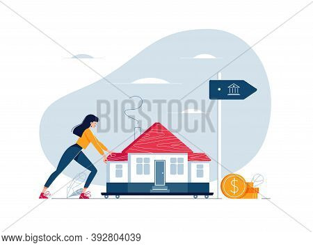 Mortgage Refinancing Concept. Woman Carries A Home To The Bank. Female Character Draggs A House For