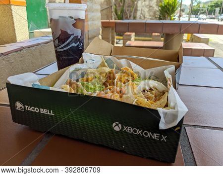 Honolulu - October 26, 2019: Taco Bell Nacho Box With Xbox One X Promotion And Dr. Pepper Drink On A