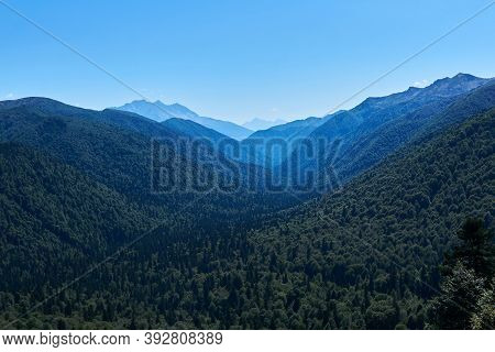 Wide River Valley Between Wooded Mountains Stretches To The Horizon In A Blue Haze