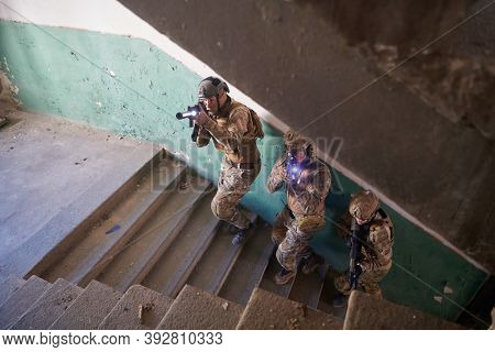 modern warfare soldiers ascent stairs in combat