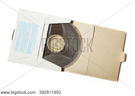 Retro Reel To Reel Tape In A Carton Box On White Background