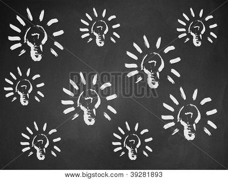 Light Bulbs On Chalkboard