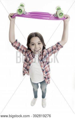 Best Gift Ever. Kid Girl Happy Raising Penny Board. Child Likes Plastic Skateboard As Gift. Modern T