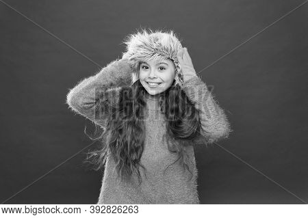 Small Fashionista Concept. Feeling So Cozy. Child Long Hair Soft Hat. Winter Fashion Concept. Warm H