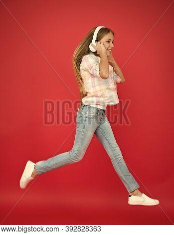 Easy Listening Music. Small Girl Listening To Music In Headphones. Dancing Girl. Happy Small Girl Da
