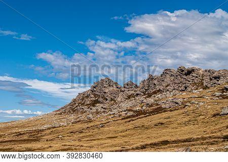 Falkland Islands, Uk - December 15, 2008: Wide Windswept Bare Landscape Of Dry Land With Gray Sharp